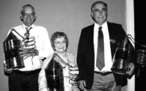 Jimmy Russell with his wife Joretta and son, Eddie Russell with trophies